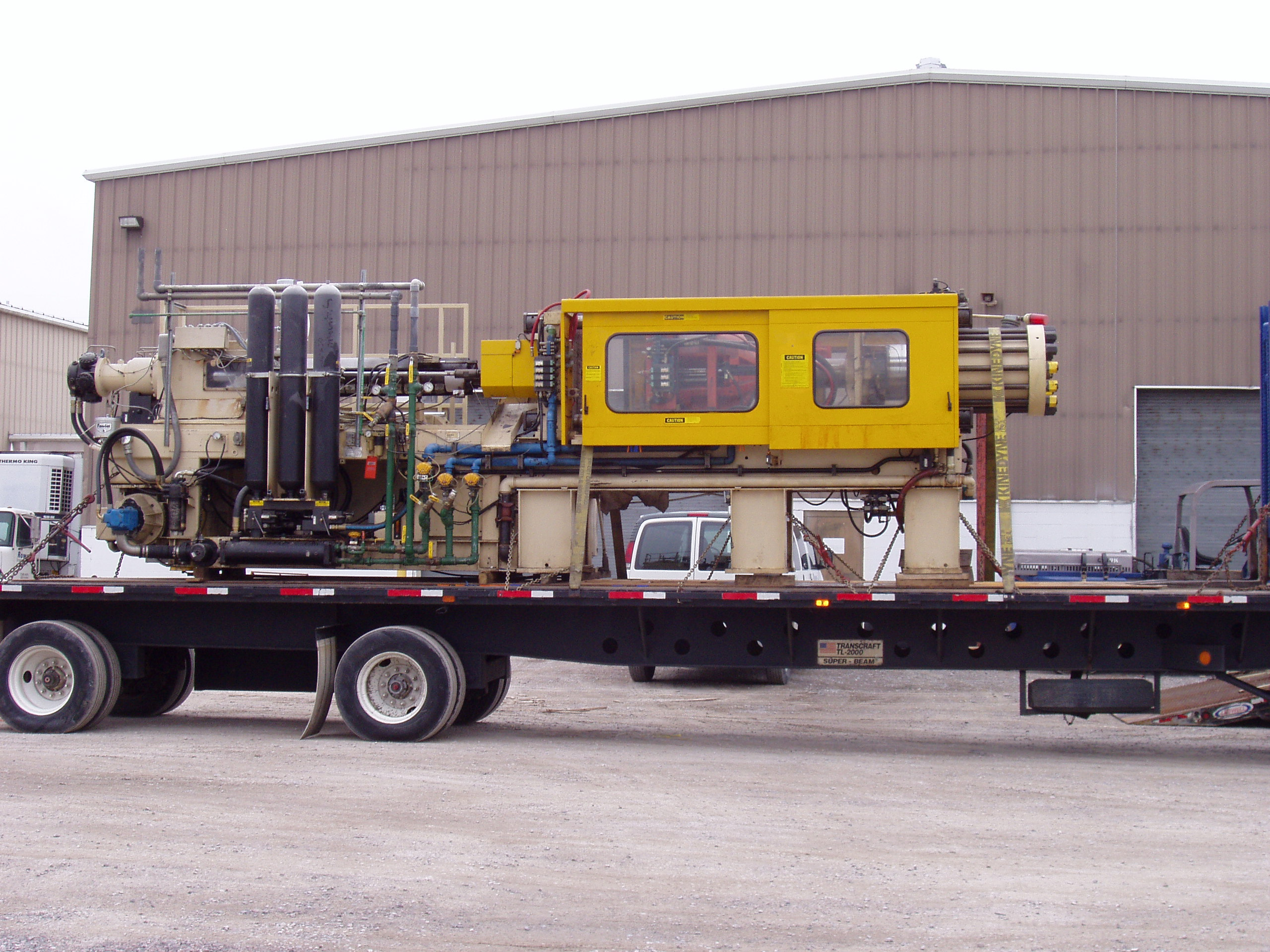 flat bed trucking carrying equipment, Rowe Transfer
