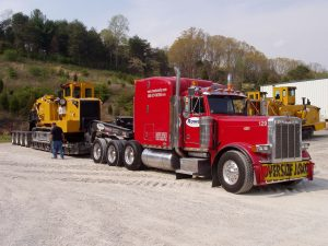 red semi pulling heavy freight