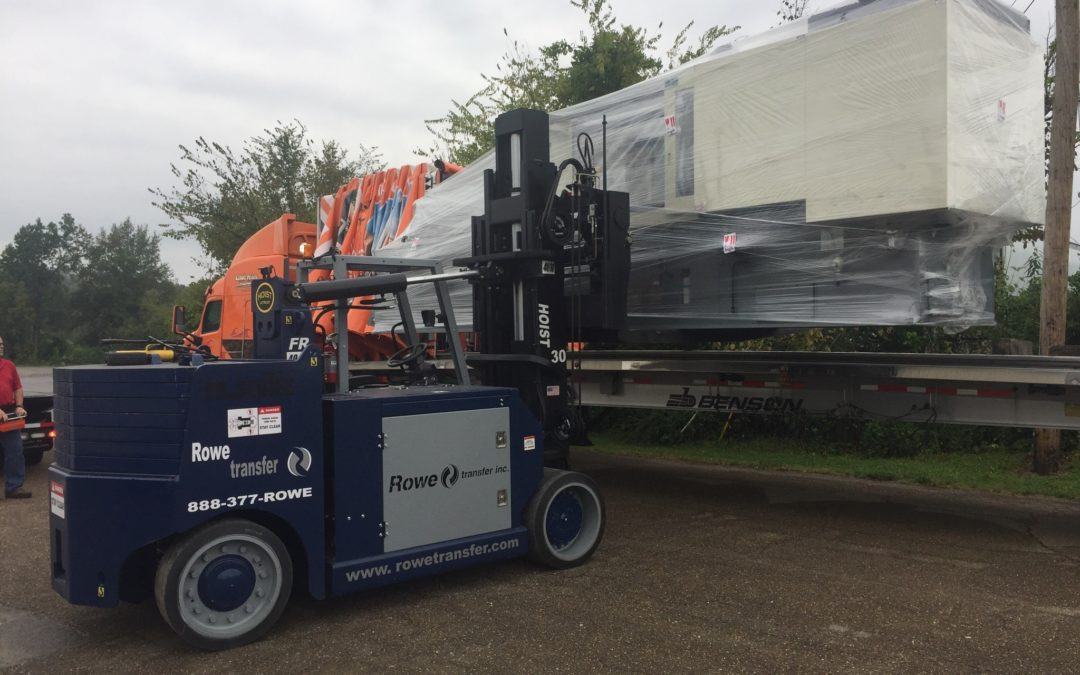 Rowe Transfer, Inc., molding machine rigged to be loaded onto semi truck